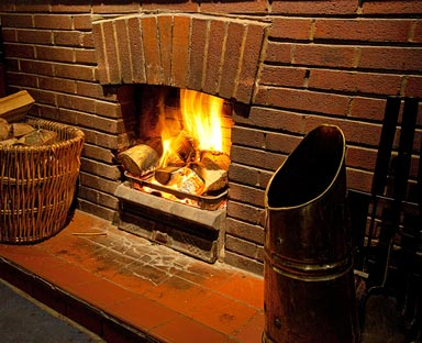 a roaring log fire burning sustainable, locally sourced Ludlow Firewood